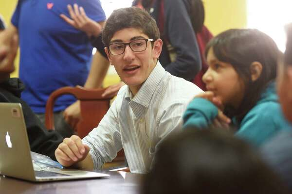 Brunswick School sophomore Oliver Nusbaum teaches the student-led Latin Club at the Don Bosco Community Center in Port Chester, N.Y. The Latin Club is one of the Paideia Institute's Aequora outreach programs, designed to promote literacy in elementary and middle school students through Latin.