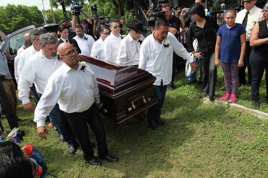 Pallbearers carry the casket of Tejano music superstar Emilio Navaira, III, as he is