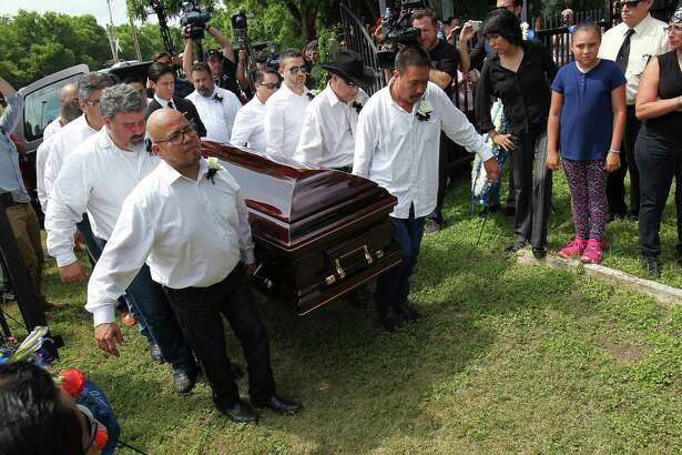 Pallbearers carry the casket of Tejano music superstar Emilio Navaira, III, as he is laid to rest at San Juan Cemetery in Berg's Mill, Monday, May 23, 2016. The funeral mass will be at San Fernando Cathedral. Navaira, 53, died suddenly on May 16 at his home in New Braunfels.