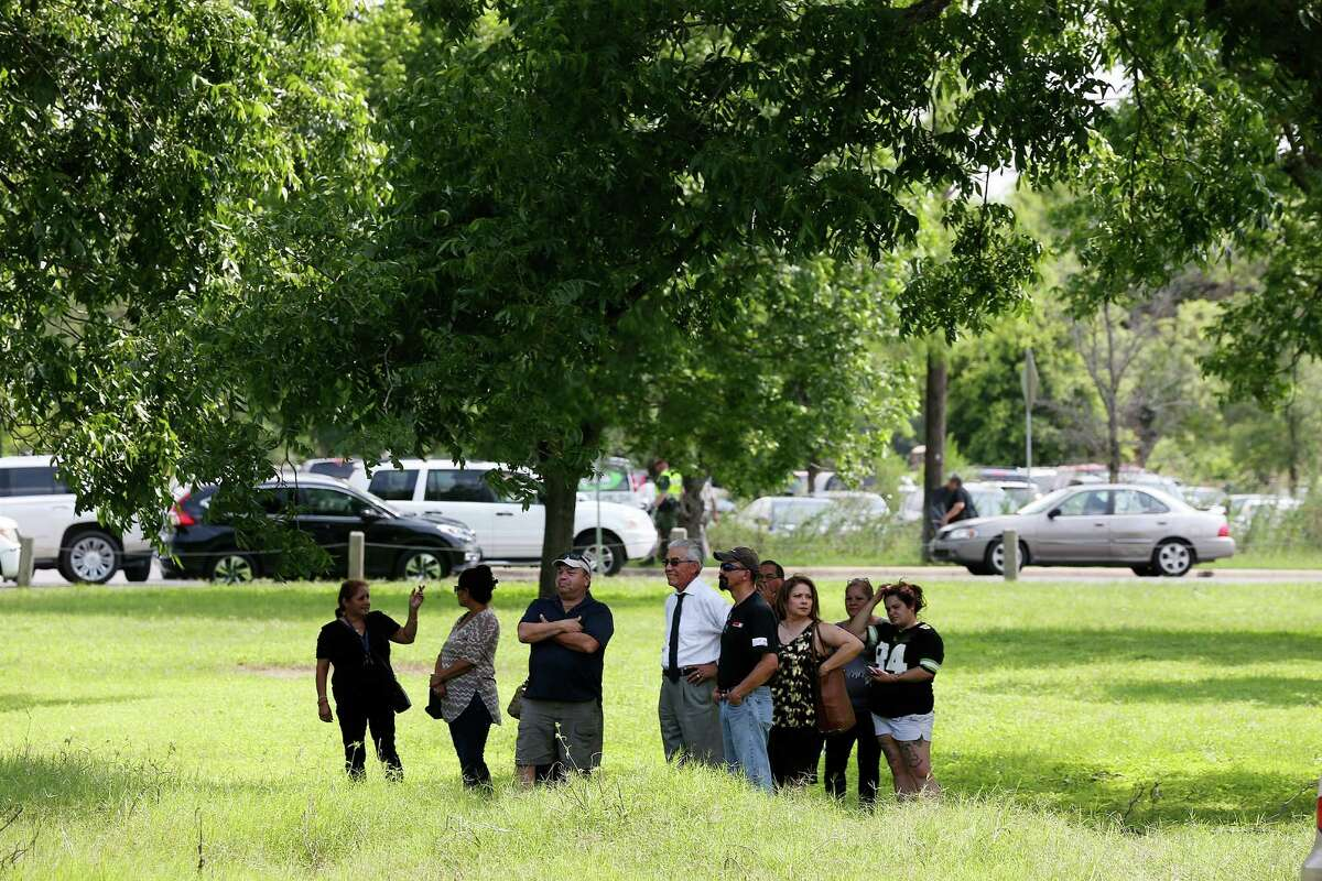 Fans gather under the shade of a tree in a field next to San Juan Cementery as Tejano music superstar Emilio Navaira, III, is laid to rest in Berg's Mill, Monday, May 23, 2016. The funeral mass will be at San Fernando Cathedral. Navaira, 53, died suddenly on May 16 at his home in New Braunfels.