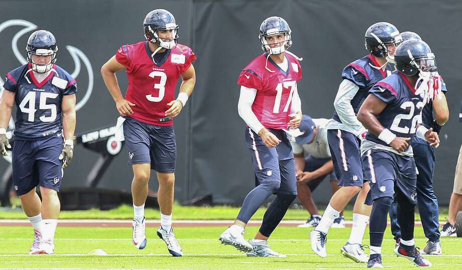 """In what amounts to a small step in a lengthy process, new Texans quarterback Brock Osweiler (17) takes the field Monday for the start of organized team activities. Of his first practice with coach Bill O'Brien, Osweiler said, """"I loved it. I loved his energy, I loved his fire."""" Photo: Steve Gonzales / © 2016 Houston Chronicle"""
