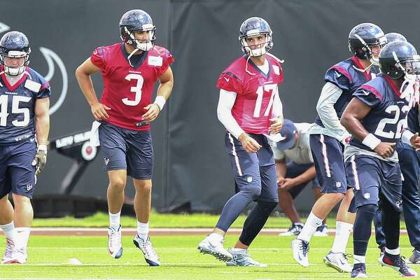 """In what amounts to a small step in a lengthy process, new Texans quarterback Brock Osweiler (17) takes the field Monday for the start of organized team activities. Of his first practice with coach Bill O'Brien, Osweiler said, """"I loved it. I loved his energy, I loved his fire."""""""