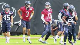 "In what amounts to a small step in a lengthy process, new Texans quarterback Brock Osweiler (17) takes the field Monday for the start of organized team activities. Of his first practice with coach Bill O'Brien, Osweiler said, ""I loved it. I loved his energy, I loved his fire."""