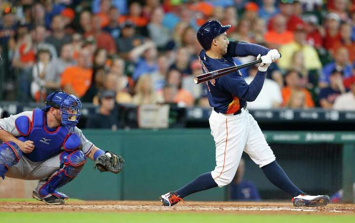 Houston Astros right fielder George Springer (4) checks his swing during the third inning of an MLB baseball game at Minute Maid Park, Sunday, May 22, 2016. ( Karen Warren  / Houston Chronicle )