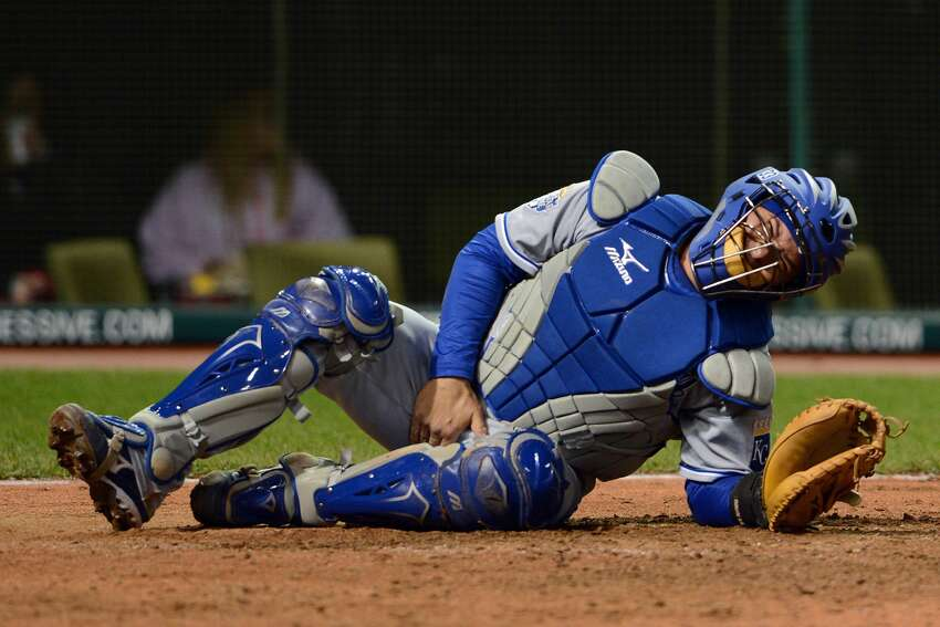 CLEVELAND, OH - APRIL 24: Catcher Humberto Quintero #33 of the Kansas City Royals reacts after being hit in the groin by a foul tip during the sixth inning against the Cleveland Indians at Progressive Field on April 24, 2012 in Cleveland, Ohio. (Photo by Jason Miller/Getty Images)