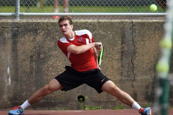 Greenwich Will Blumberg hits a shot in No. 1 Greenwich's win over No. 5 Darien in the FCIAC semifinal tennis match at Greenwich High School in Greenwich, Conn. Monday, May 23, 2016.