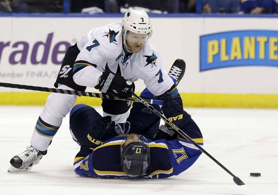 San Jose Sharks defenseman Paul Martin (7) chases the puck against St. Louis Blues left wing Jaden Schwartz (17) during the second period in Game 5 of the NHL hockey Stanley Cup Western Conference finals, Monday, May 23, 2016, in St. Louis. (AP Photo/Jeff Roberson) Photo: Jeff Roberson, Associated Press