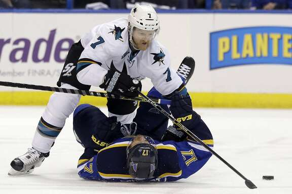 San Jose Sharks defenseman Paul Martin (7) chases the puck against St. Louis Blues left wing Jaden Schwartz (17) during the second period in Game 5 of the NHL hockey Stanley Cup Western Conference finals, Monday, May 23, 2016, in St. Louis. (AP Photo/Jeff Roberson)