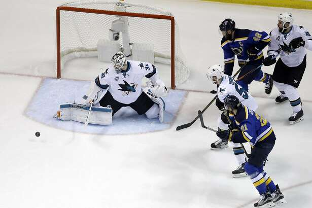 San Jose Sharks goalie Martin Jones (31) blocks a shot during the first period in Game 5 of the NHL hockey Stanley Cup Western Conference finals against the St. Louis Blues, Monday, May 23, 2016, in St. Louis. (AP Photo/Jeff Roberson)