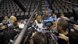 Draymond Green is surrounded by reporters as he talks with the press addressing the flagrant 1, technical foul assessed to him during Game 3 before the Golden State Warriors practiced at Chesapeake Energy Arena in Oklahoma City on May 23, 2016.