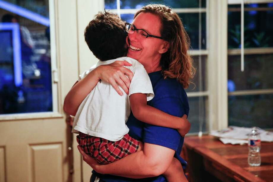 Angela Sugarek laughs and hugs her four-year-old foster child at their house Monday, May 23, 2016 in Houston. The foster parents, Sugarek and Carol Jeffery, welcomed their two foster kids, brothers ages 3 and 4, back into their home almost two months after Child Protective Services took the kids away after they reported the youngest child was being abused by an older brother. Photo: Michael Ciaglo, Houston Chronicle / © 2016  Houston Chronicle