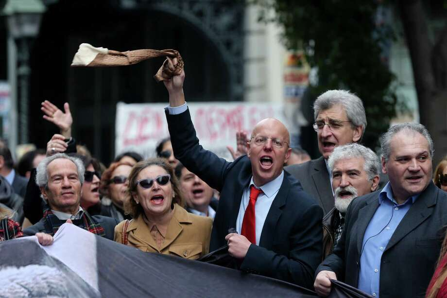 A lawyer waves his tie as others shout slogans during a protest earlier this year in Athens. Greek lawyers have been on strike for months against austerity measures that impose heavy taxes on self-employed professionals. Photo: Petros Giannakouris, STF / Copyright 2016 The Associated Press. All rights reserved. This material may not be published, broadcast, rewritten or redistribu