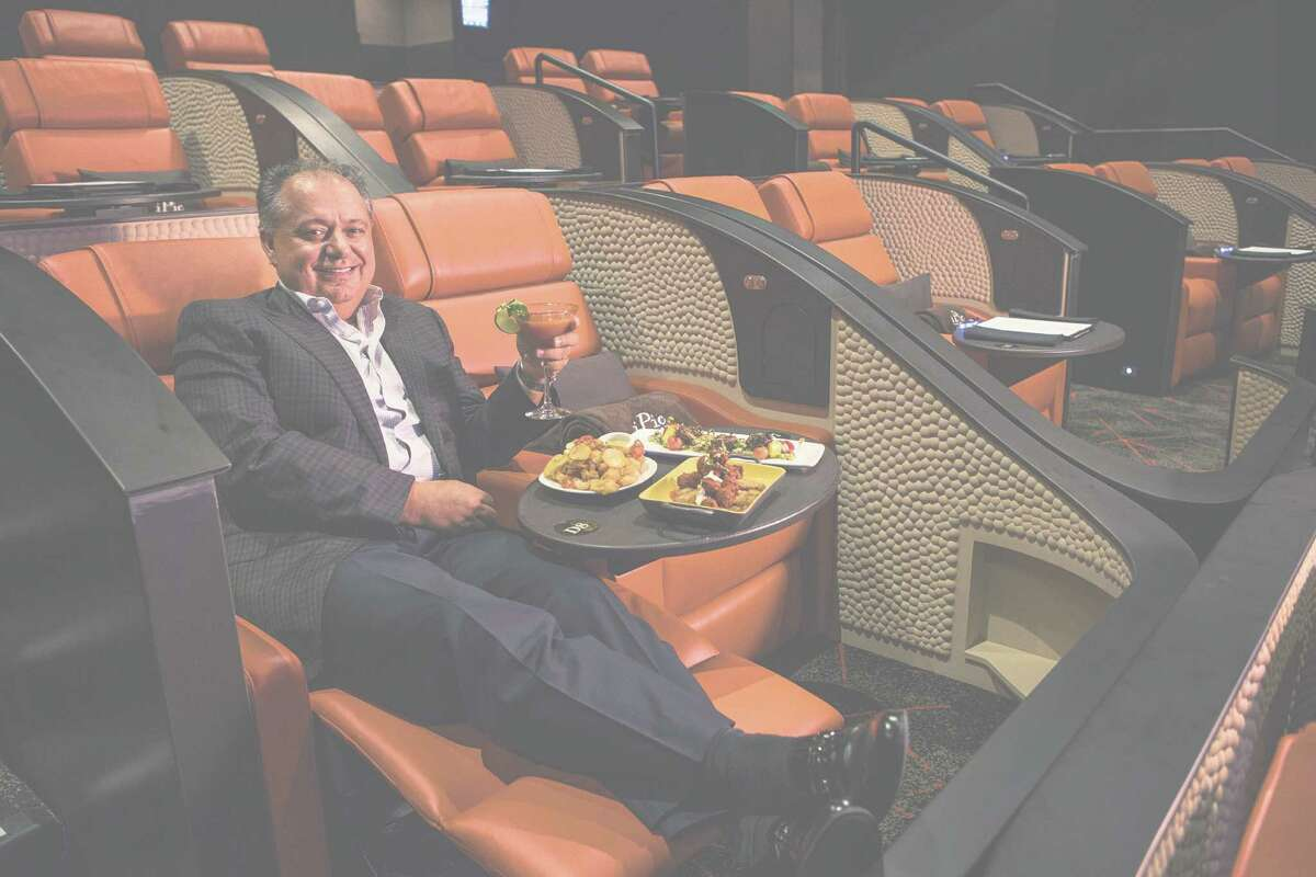 Hamid Hashemi, iPic Entertainment CEO, tried out a seat before one of his theaters opened in Houston last fall. His company is suing two major theater chains.