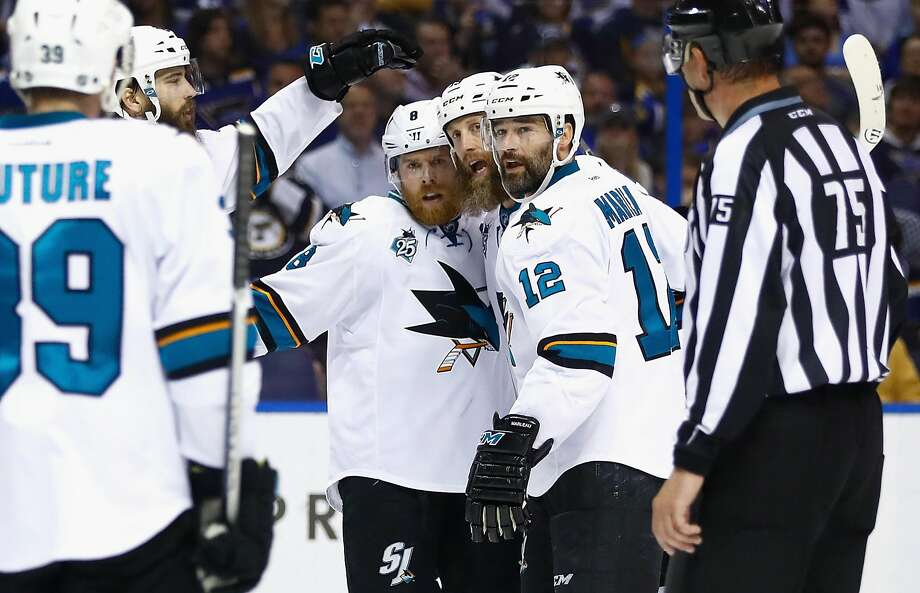 Joe Thornton (center, with Joe Pavelski at left), and Patrick Marleau (right) are still key Sharks at age 37. Photo: Jamie Squire, Getty Images