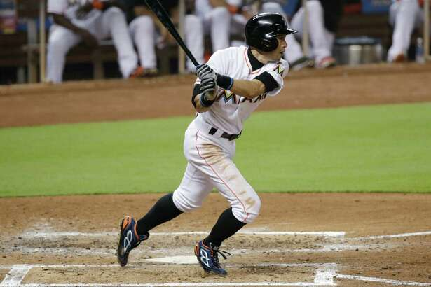 Miami Marlins' Ichiro Suzuki, of Japan, hits a single during the fourth inning of a baseball game against the Tampa Bay Rays, Monday, May 23, 2016, in Miami. Suzuki had four hits as the Marlins rallied past the Rays 7-6. (AP Photo/Wilfredo Lee) ORG XMIT: FLWL111