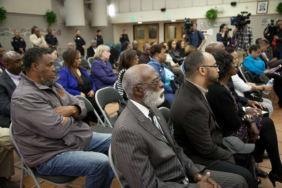 Arelious Walker, center, listens in to acting police chief Toney Chaplin (not pictured) during a community meeting at the Southeast Community Facility on Monday, May 23, 2016 in San Francisco, Calif. Photo: Santiago Mejia, Special To The Chronicle