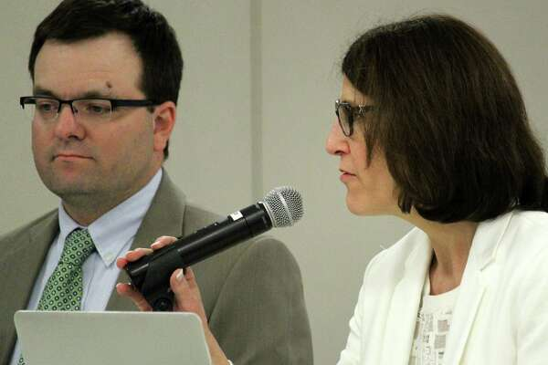 James D'Amico and Julie Droller, respectively, the school district's directors of secondary and elementary education, discuss their review of school day schedules at Monday's Board of Education meeting.