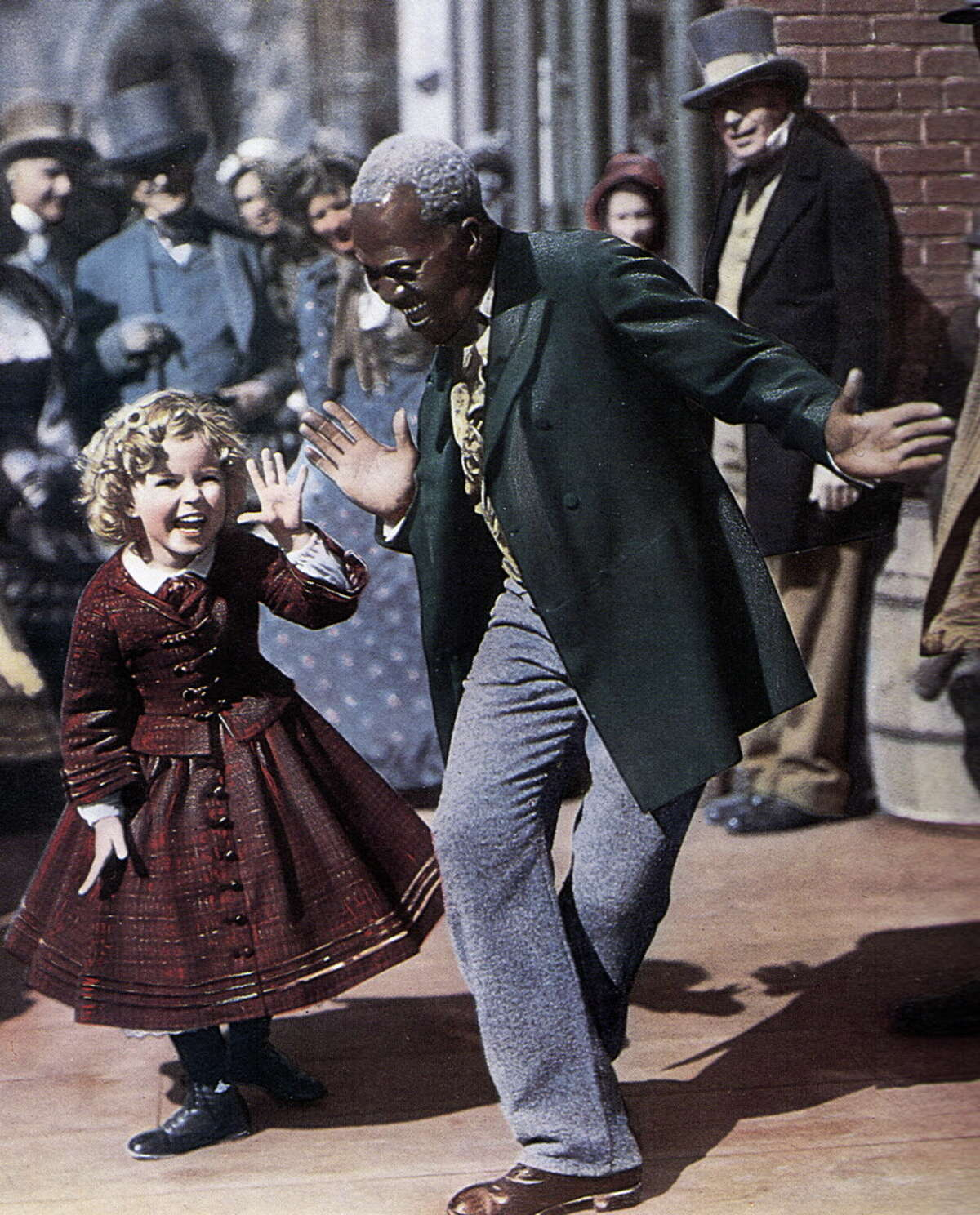 """Bill """"Bojangles"""" Robinson Robinson and Shirley Temple, dancing in a scene from one of their films from 1935. Robinson was adept at both the buck-and-wing style of dancing and Irish step dance. He and Temple starred in four movies together."""