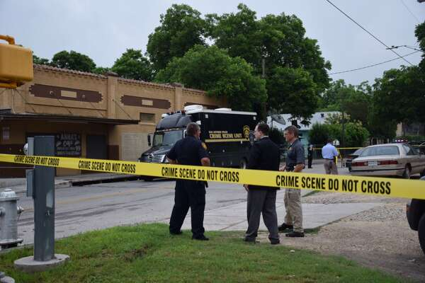 SAPD investigates a shooting scene in the 2300 block of East Houston Street that left one man dead on the East Side Tuesday morning, May 24, 2016.