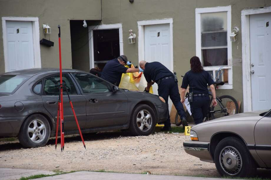 SAPD investigates a shooting scene in the 2300 block of East Houston Street that left one man dead on the East Side Tuesday morning, May 24, 2016. Photo: Mark D. Wilson/San Antonio Express-News
