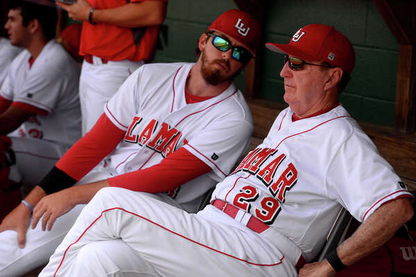 Lamar pitcher Will Hibbs talks with Coach Jim Gilligan in the dugout during Gilligan's last home game as coach of Lamar's baseball team on Sunday. Gilligan has been part of Lamar baseball for more than 40 years, including his time as a player.  Photo taken Sunday 5/15/16 Ryan Pelham/The Enterprise