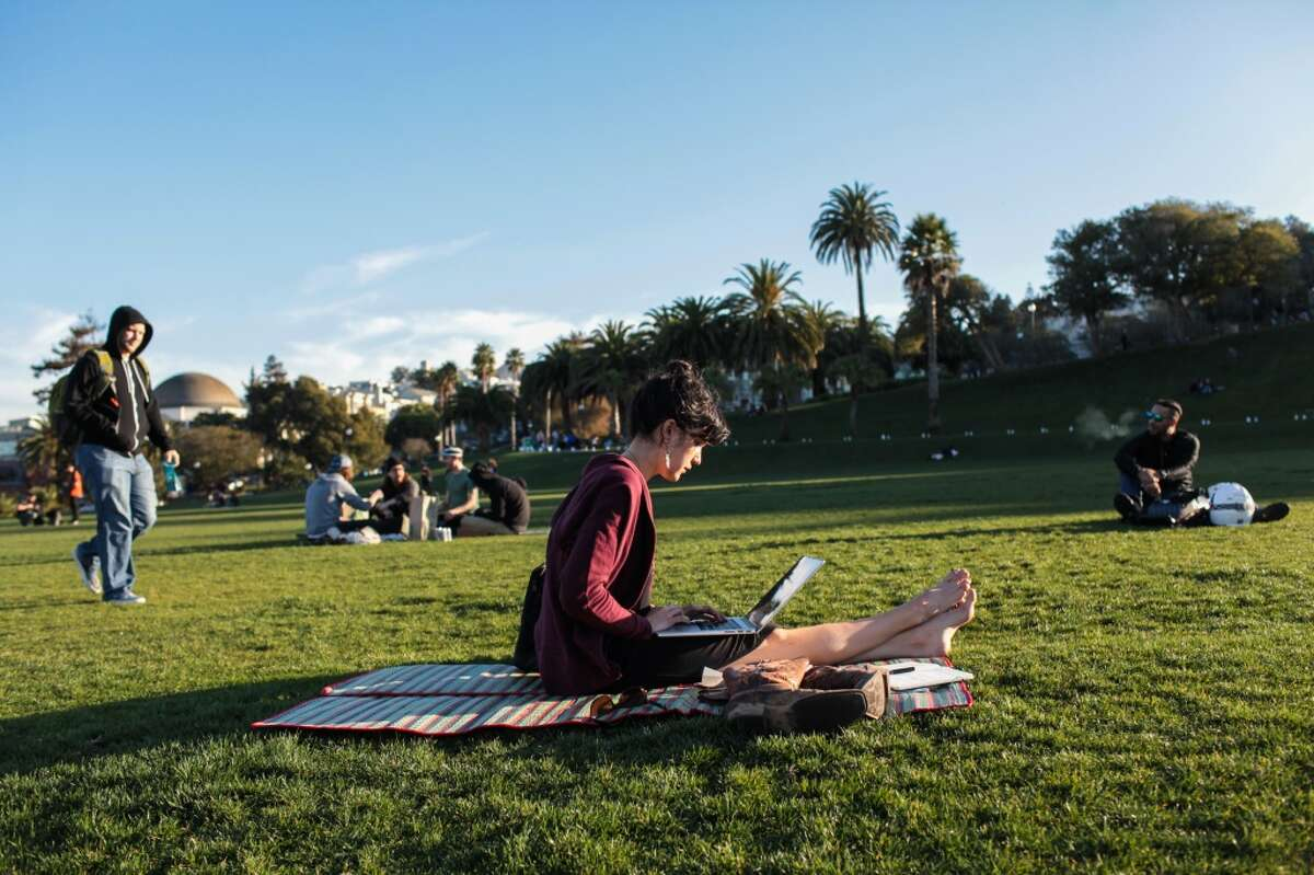 Debbi La Rue (center) works on a picnic blanket at Dolores Park in San Francisco, California on Wednesday, January 27, 2016.