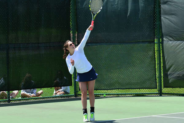 Junior Blair Marine serves during the FAA tournament at GFA May 16. Marine and doubles partner senior Lydia Picoli made it to the second round in the tournament.