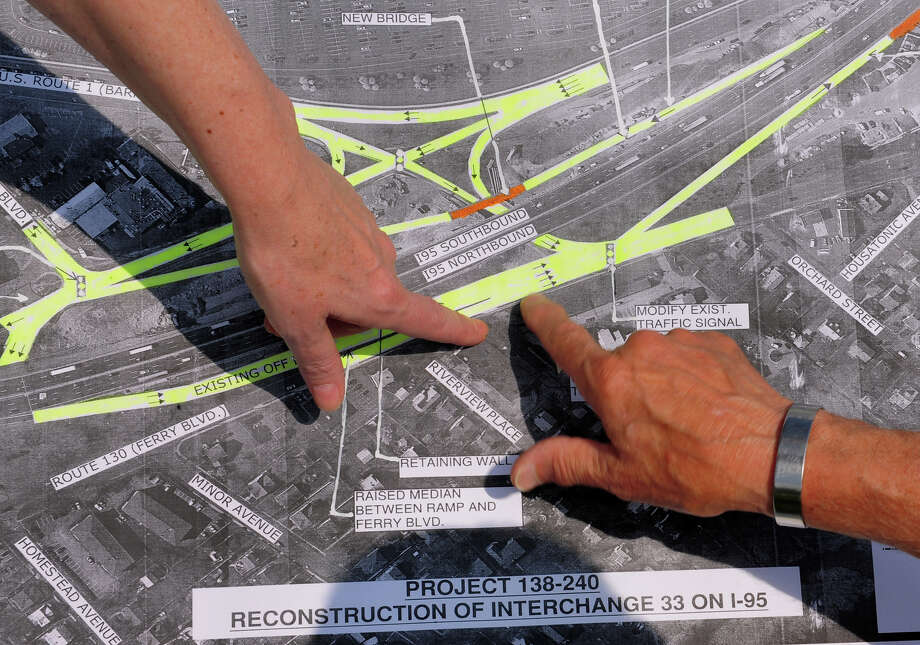Charles Perez, President of S.A.F.E. (Stratford Action for the Environment), pointing from top, shows a map of the I95 corridor through Stratford and talks about the environmental impact of the proposed plans to expand exit 33 off of I95 at Ferry Boulavard in Stratford, Conn. on Wednesday June 25, 2014. Photo: Christian Abraham / Christian Abraham / Connecticut Post