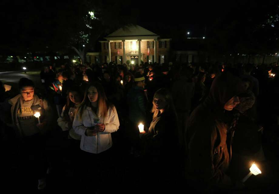 "In this Monday, Feb. 8, 2016 file photo, Baylor students and alumni hold a candlelight vigil outside the home of Baylor University President Ken Starr in what organizers' call a ""Survivors' Stand"" in Waco, Texas. Photo: Rod Aydelotte, AP / Waco Tribune Herald"