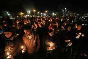 """FILE - In this Monday, Feb. 8, 2016 file photo, Baylor students and alumni hold a candlelight vigil outside the home of Baylor University President Ken Starr in what organizers' call a """"Survivors' Stand"""" in Waco, Texas. The event was held in an effort to urge changes to how the school handles sexual assault. The university did not report a single instance of sexual assault in a four-year span, according to federal statistics, a finding that represents a sharp contrast to multiple reports at two smaller private schools in Texas over the same period. (Rod Aydelotte/Waco Tribune Herald via AP, File)"""
