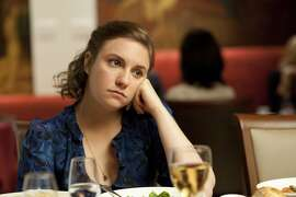 """This undated image released by HBO shows Lena Dunham in a scene from the series """"Girls."""" Dunham was nominated for a Golden Globe for best actress in a comedy series, Thursday, Dec. 13, 2012, for her role in """"Girls."""" The 70th annual Golden Globe Awards will be held on Jan. 13. (AP Photo/HBO, JoJo Whilden)"""
