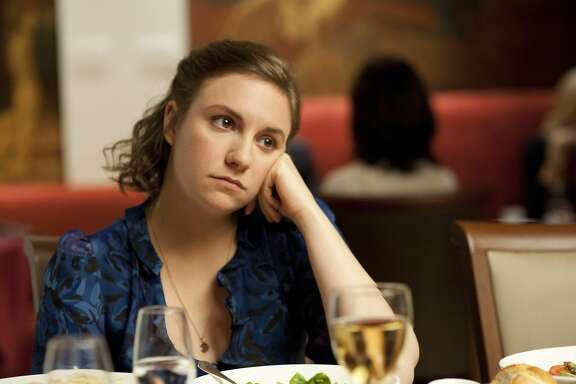 "This undated image released by HBO shows Lena Dunham in a scene from the series ""Girls."" Dunham was nominated for a Golden Globe for best actress in a comedy series, Thursday, Dec. 13, 2012, for her role in ""Girls."" The 70th annual Golden Globe Awards will be held on Jan. 13. (AP Photo/HBO, JoJo Whilden)"