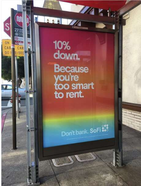 An ad for SoFi appearing on the sides of bus stops around San Francisco basically calls anyone who rents stupid—and many aren't happy about this. Photo: Jacob Ma-Weaver