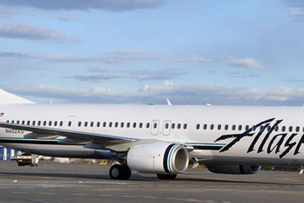 Alaska Airlines' new Boeing 737-900ER aircraft is scheduled to be making low-flying passes over San Francisco on Tuesday as a film crew in a Lear jet tails it to shoot a commercial, police said.