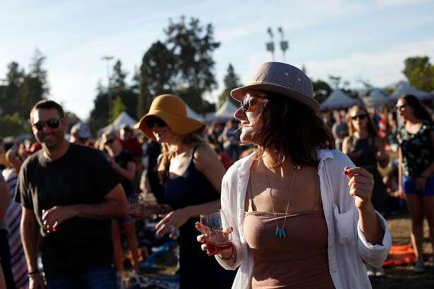 Kim Macke of San Francisco dances along to The Avett Brothers at BottleRock in Napa, Calif., on Saturday, May 30, 2015.