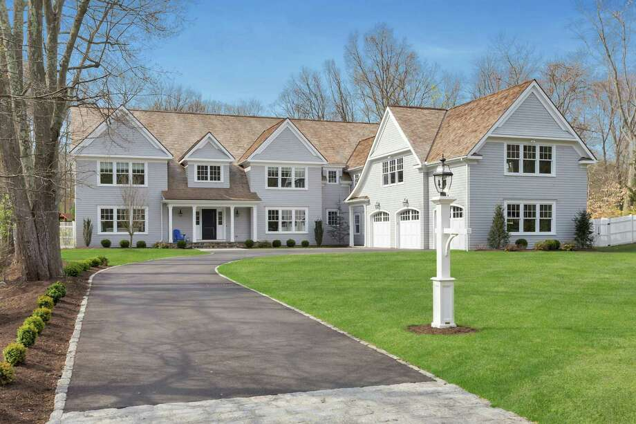 Tucked on a quiet Darien lane, an award-winning transitional-style Colonial offers a skillfully designed floor plan with craftsman details both inside and out. Photo: Darien News / Contributed Photos / Darien News
