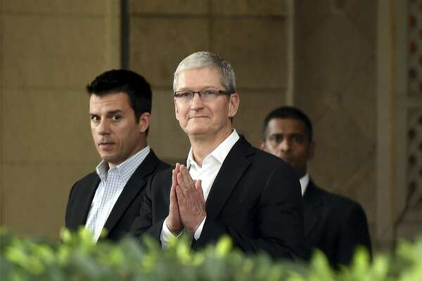 Apple chief Tim Cook, greets in Indian style at the Taj Mahal hotel in Mumbai, India, Wednesday, May 18, 2016. Apple will set up an app design and development center in southern India, the company announced Wednesday, shortly after company chief Tim Cook arrived in the country on his first visit. (Press Trust of India via AP)