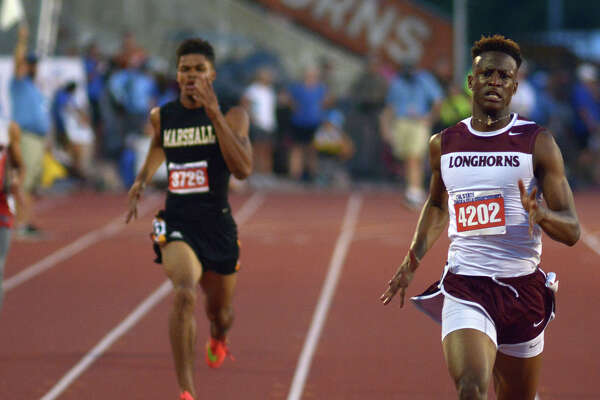 George Ranch junior Champion Allison, right, pulls ahead of Fort Bend Marshall senior John Isom at the finish line during the Class 5A boys 400-meter dash at the UIL Track & Field Championships earlier this month.