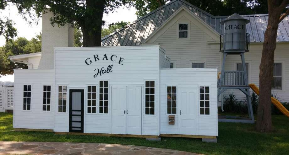 """The exterior of """"Grace Hall,"""" the 140-square-foot replica of Gruene Hall. Photo: Provided By Lilliput Play Homes"""