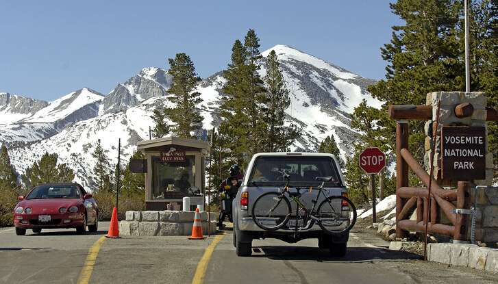 Tourists line up to pay the entrance fees at the Tioga Pass entrance in Yosemite National Park, Calif., Friday, June 24, 2005. At elevation 9,945 feet, Tioga Pass is the last to open for this season in California. The Kuna Crest can be seen in the background. (AP Photo/Al Golub)