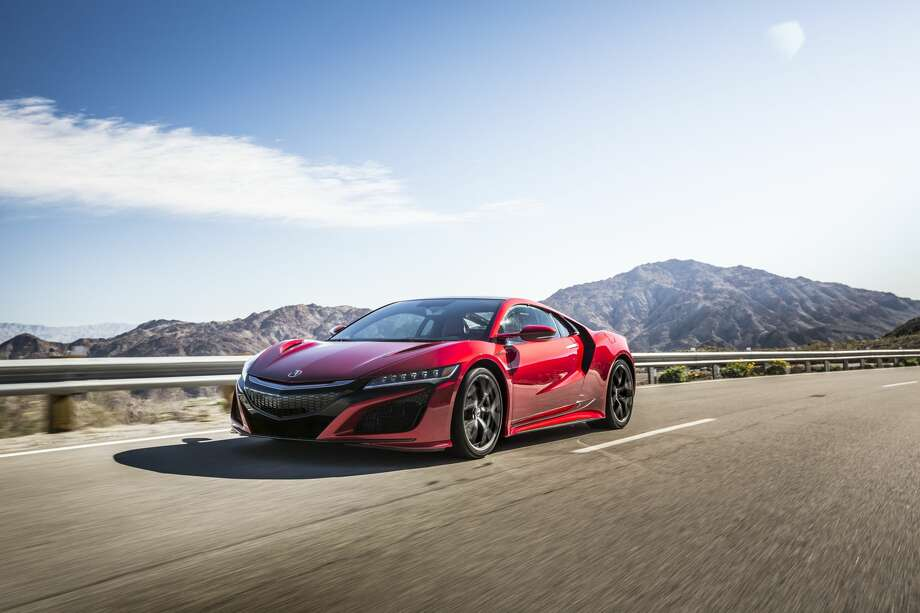 2017 Acura NSXBase price: $157,800Price, as tested: $202,960Engine: 3.5-liter twin-turbo V-6 hybridPower: 573 hpTop speed: 191 mph (est)Source: Road & Track Photo: Acura