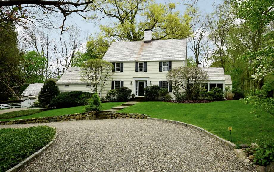 A charming 1934 Colonial tucked on a private shared drive on White Oak Shade Road offers a warm and inviting country home on a stunning piece of property. Photo: Contributed Photos / Hearst Connecticut Media / New Canaan News