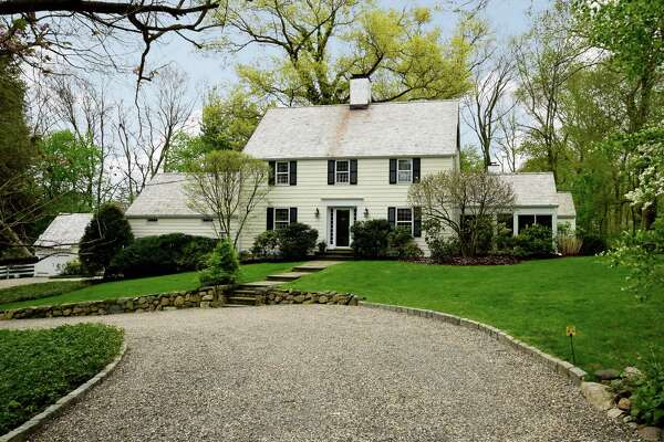 A charming 1934 Colonial tucked on a private shared drive on White Oak Shade Road offers a warm and inviting country home on a stunning piece of property.