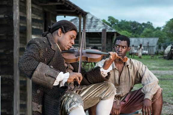 "Fiddler (Forest Whitaker, left) becomes a father figure to Kunta Kinte (Malachi Kirby), who rebels against his status as a slave in ""Roots."""
