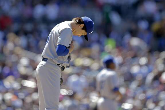 Los Angeles Dodgers starting pitcher Kenta Maeda pauses before pitching against a San Diego Padres batter during the fifth inning of a baseball game Sunday, May 22, 2016, in San Diego. (AP Photo/Gregory Bull)