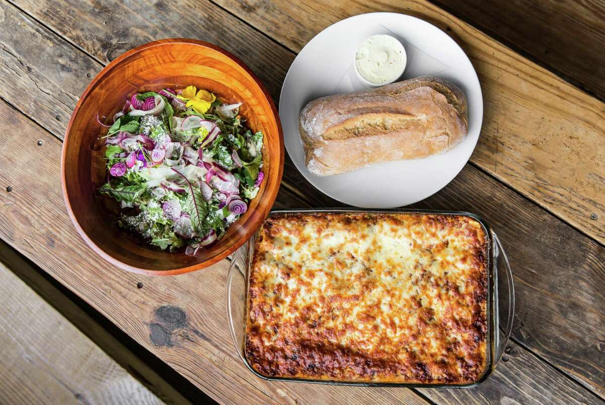 Mama Shepherd's Lasagna (layers of beef, pork, cheese and tomato) served with salad and garlic bread, are among the new family-style dishes at the Hay Merchant, Houston.