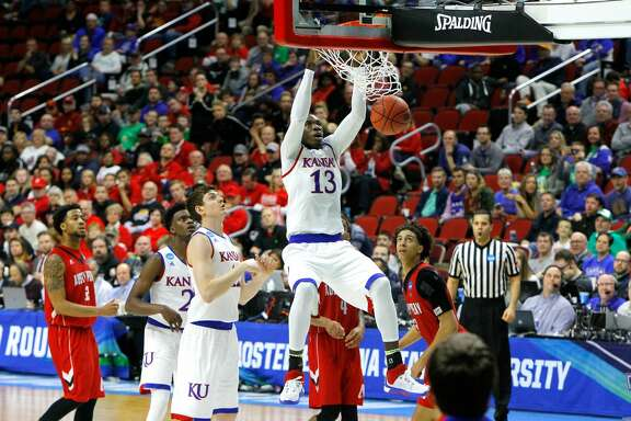 DES MOINES, IA - MARCH 17:  Cheick Diallo #13 of the Kansas Jayhawks dunks in the second half against the Austin Peay Governors during the first round of the 2016 NCAA Men's Basketball Tournament at Wells Fargo Arena on March 17, 2016 in Des Moines, Iowa.  (Photo by Kevin C. Cox/Getty Images)