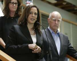 Attorney General Kamala Harris thanks California Gov. Jerry Brown, right, after he announced his endorsement of her for the U.S. Senate during a news conference at the California Democratic Party headquarters in Sacramento, Calif. Harris is running against fellow Democrat, Rep. Loretta Sanchez, among others, to replace Barbara Boxer who is retiring. (AP Photo/Rich Pedroncelli)
