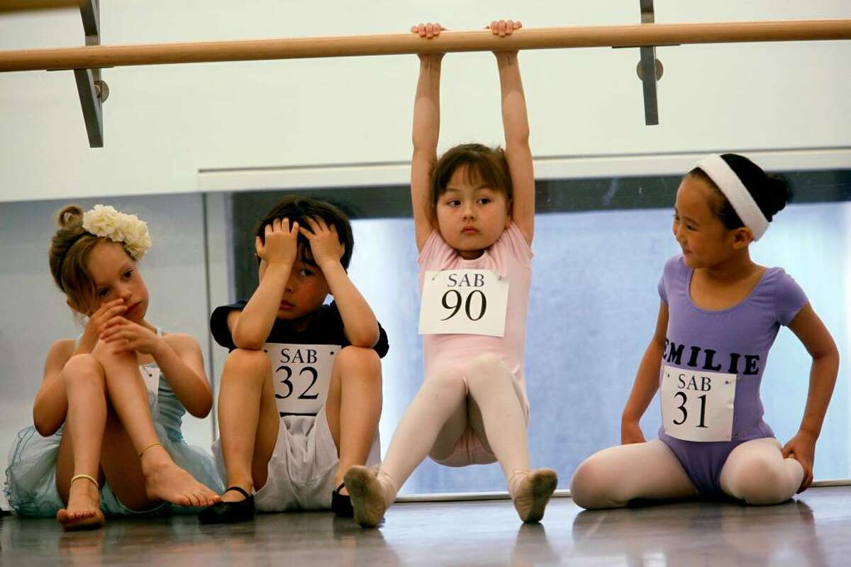 Children wait to audition for the School of American Ballet, Monday, April 19, 2010 in New York. The audition was the first in a series conducted for students between the ages of 6 and 10. (AP Photo/Mary Altaffer)