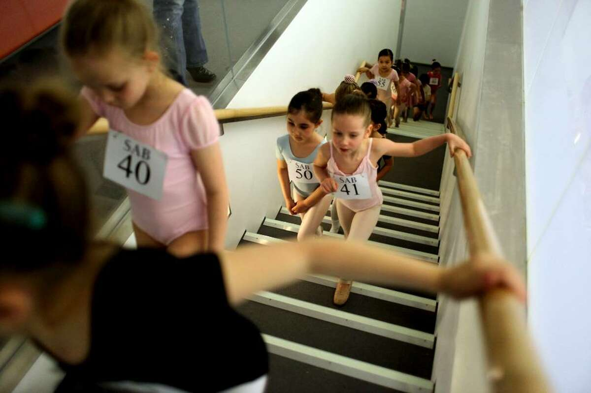 Children line up before auditioning for the School of American Ballet, Monday, April 19, 2010 in New York. The audition was the first in a series conducted for students between the ages of 6 and 10. (AP Photo/Mary Altaffer)